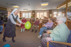 St. Monica's residents enyoying a balloon fun exercise session.