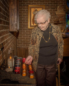 St. Monica resident lighting candles.