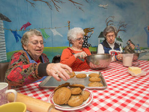 St. Monica residents decorate cookies as an activity.