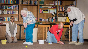 St Monica residents trying their hand at putting.